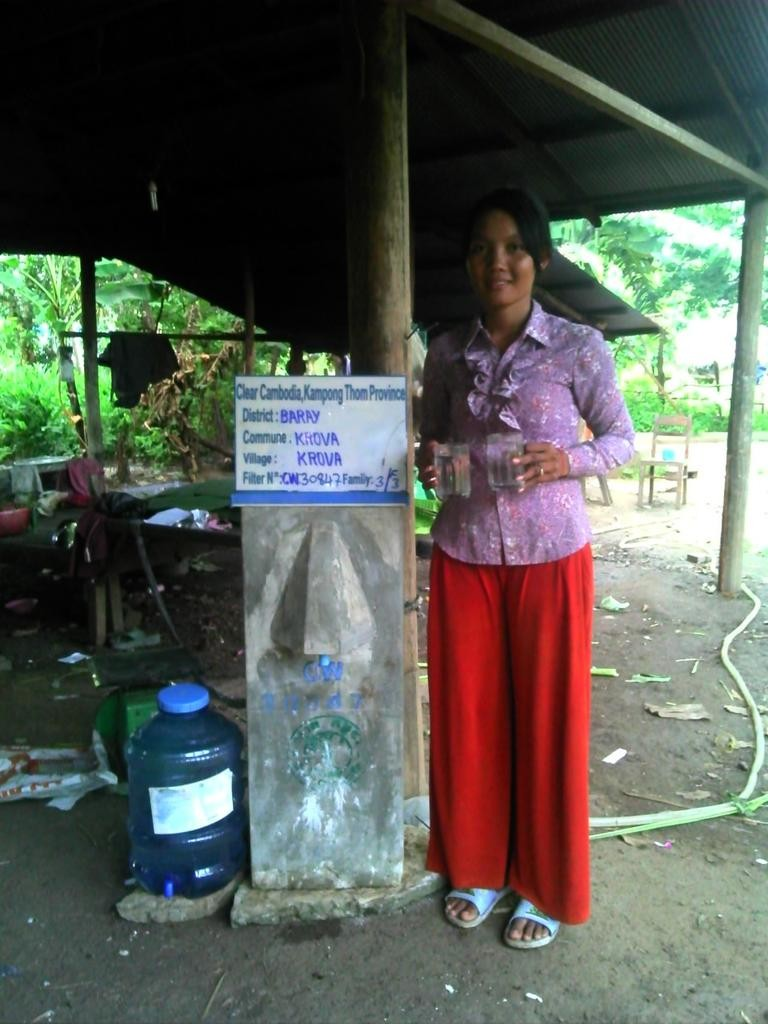 Woman at a Kra Va Community BioSand Filter